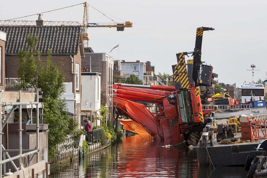 Two collapsed cranes are seen in Alphen aan de Rijn, the Netherlands on Aug 3.