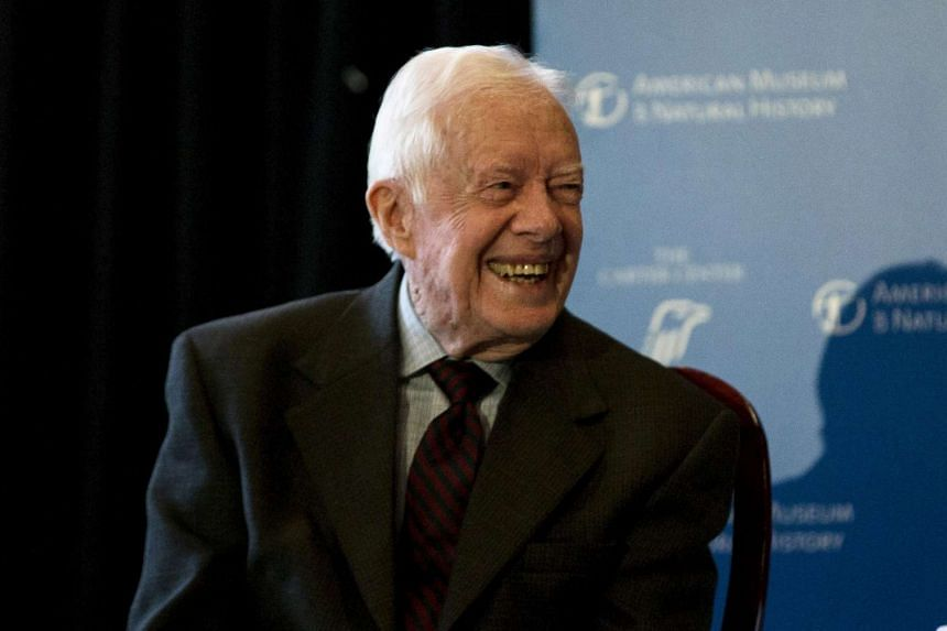 "Former U.S. president Jimmy Carter spoke at the opening of a new exhibit, ""Countdown to Zero, Defeating Disease"" at the American Museum of Natural History in New York on Jan 12, 2015"