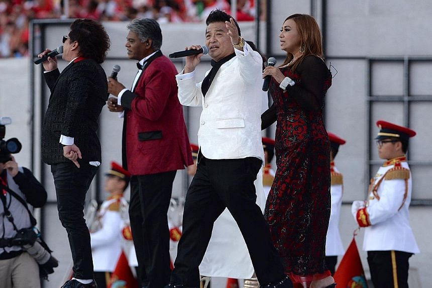 (From left) Douglas Oliverio, Robert Fernando, Clement Chow and Jacintha Abisheganaden singing during an NDP rehearsal.