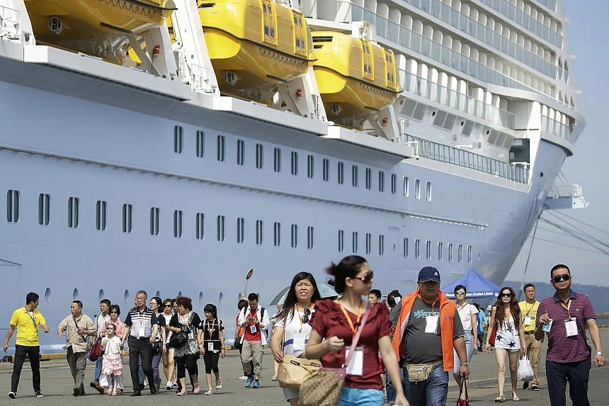 Chinese tourists at the port of Hakata in Fukuoka, after arriving in Japan on the Quantum of the Seas cruise ship. Four million Chinese tourists - a two-thirds increase from last year - are expected to head to Japan this year, and ships like the SkyS
