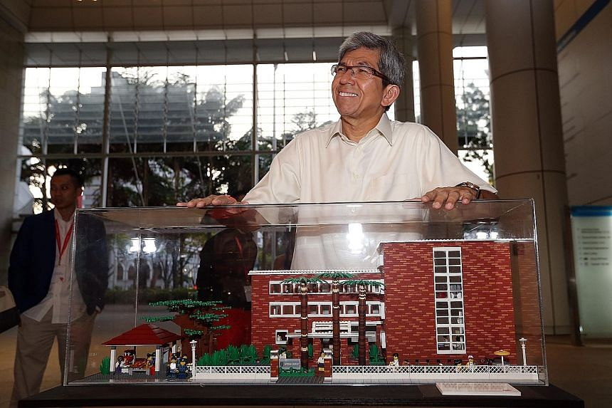 """A mini Lego replica of the former red-brick National Library building brought back good memories for Minister for Communications and Information Yaacob Ibrahim yesterday. The display is part of """"The Little Red Brick"""" Lego art installation, which also"""
