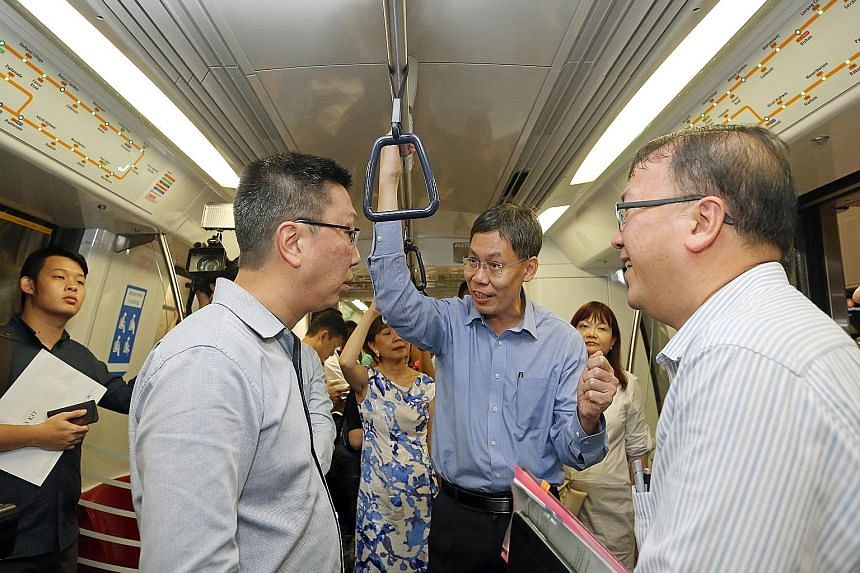 Transport Minister Lui Tuck Yew (centre) with LTA chief executive Chew Men Leong (left) and deputy chief executive for infrastructure and development Chua Chong Kheng riding one of the new trains on the Circle Line yesterday.