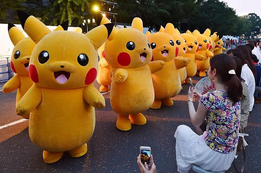 Dressed up as Pikachu, the popular Pokemon animation series character, these people performed at the Yokohama Dance Parade in the Japanese city on Sunday. The dance festival began last Saturday and will run for 65 days throughout the city, with over