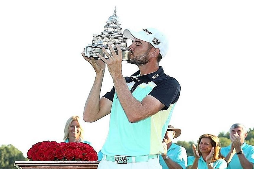 Troy Merritt kissing the trophy after winning the Quicken Loans National.
