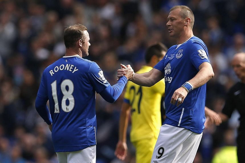 Wayne Rooney (with Everton great Duncan Ferguson, right) said he was a bit apprehensive if the Goodison Park crowd would still be on his side. He started his career at the club before moving to Man United.
