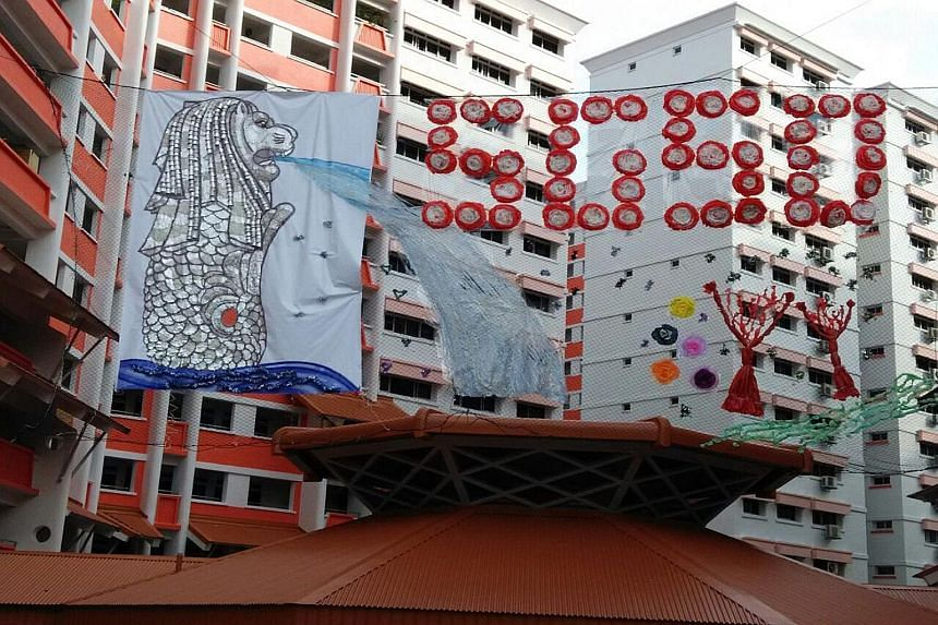 A 3D display of a Merlion hanging between blocks 504 and 505 in Choa Chu Kang Street 51. It was made by residents and members of Yew Tee Zone 4 RC out of aluminium foil and other recycled materials.