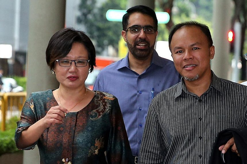 (From left) Workers' Party and AHPETC chairman Sylvia Lim arriving at the Supreme Court yesterday with fellow Aljunied GRC MPs Pritam Singh and Muhamad Faisal Abdul Manap.