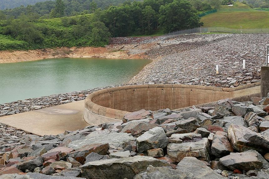 The water level in Johor's Linggiu Reservoir, which helps supply water from Malaysia to Singapore, at more than 100 per cent (above) in October 2012 and at 55 per cent (below) this month. Minister for the Environment and Water Resources Vivian Balakr
