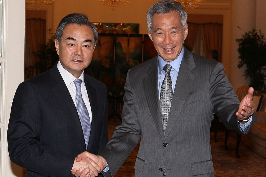 Chinese Foreign Minister Wang Yi (left) calling on Prime Minister Lee Hsien Loong yesterday. China and Singapore have agreed to launch a third government-to-government project, said Mr Wang.