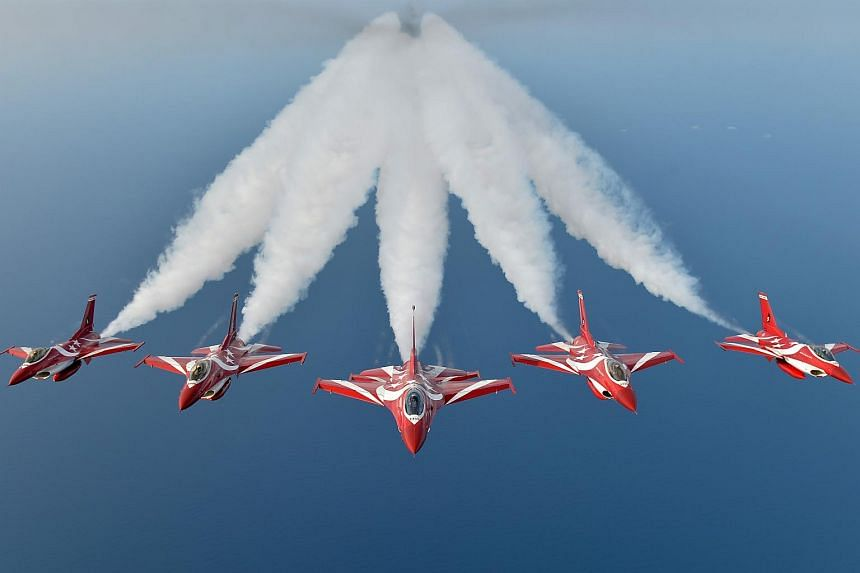 The RSAF Black Knights fly in a Arrow Head formation.