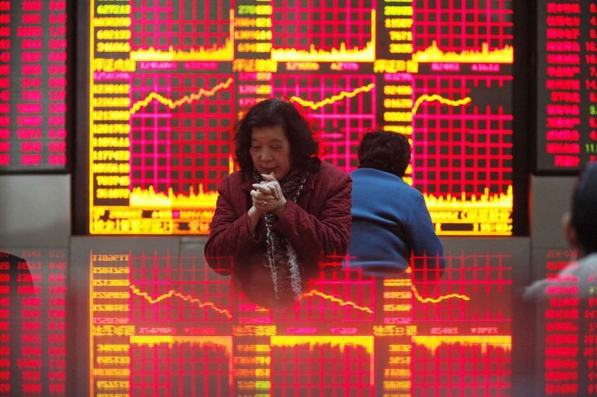 A file picture of investors at a securities exchange firm in Shanghai.PHOTO: BLOOMBERG