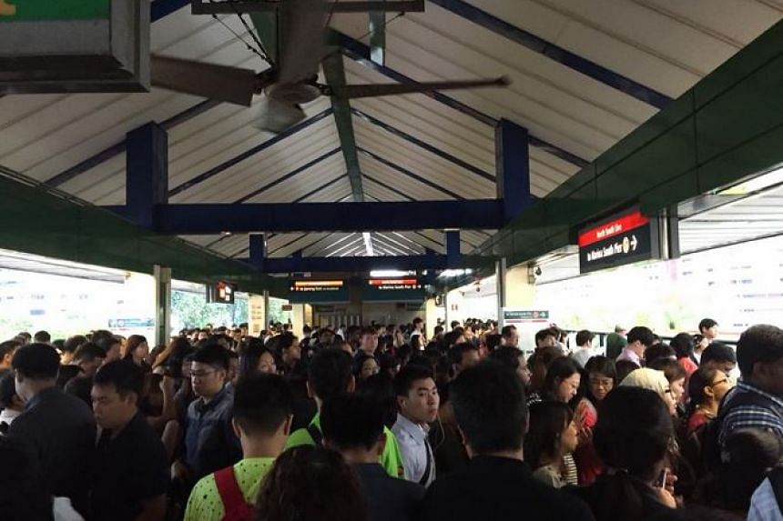 The crowded platform at Yishun MRT station at around 8am.