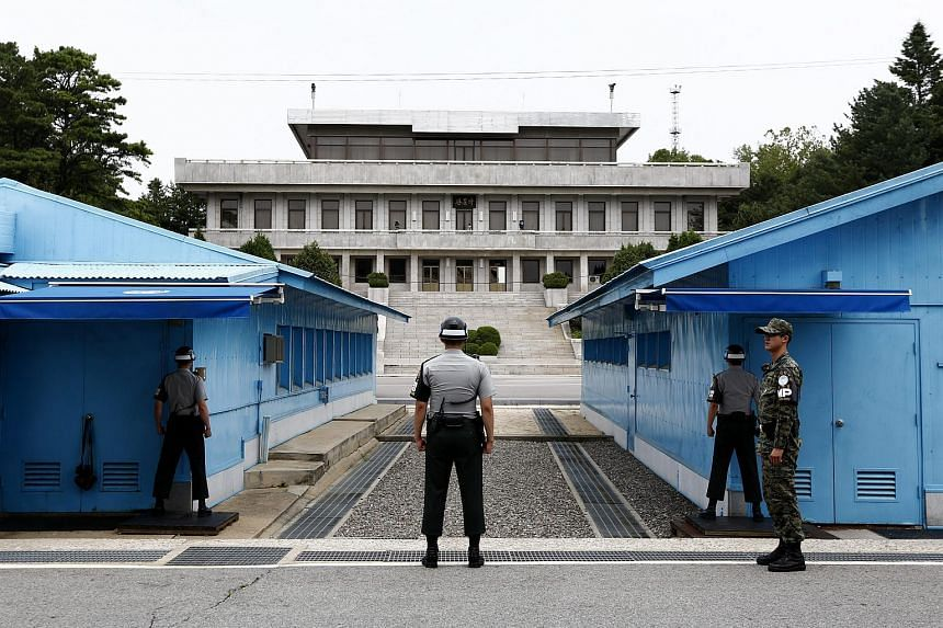 South Korean soldiers stand guard at the Military Demarcation Line in the Demilitarized Zone (DMZ).