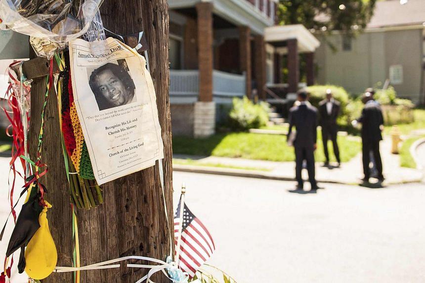 An impromptu memorial for Samuel Dubose is posted near the crime scene in Cincinnati, Ohio, on July 30, 2015.