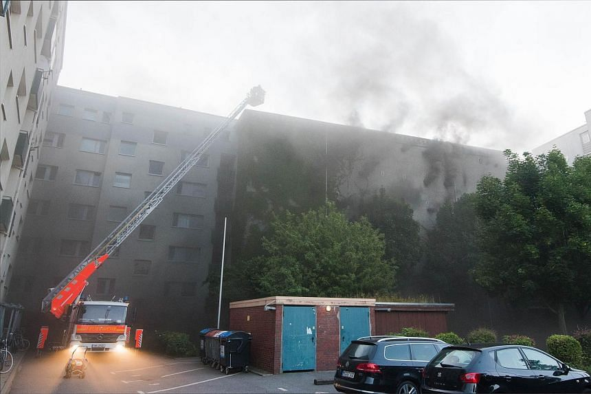 Firefighters try to extinguish a fire at a WWII bunker on Aug 4, 2015 in Hamburg amid an explosion that wounded 21 people.