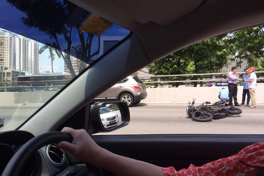 A motorcycle is seen on its side on the CTE on Tuesday on Aug 4, 2015.