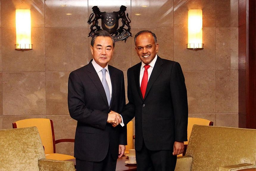 Minister for Foreign Affairs and Law K Shanmugam with Minister of Foreign Affairs of the People's Republic of China Wang Yi on August 3, 2015.