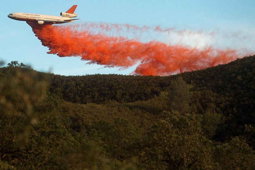 An air tanker drops retardant to stop the Rocky fire from spreading as it burns near Clearlake, California.