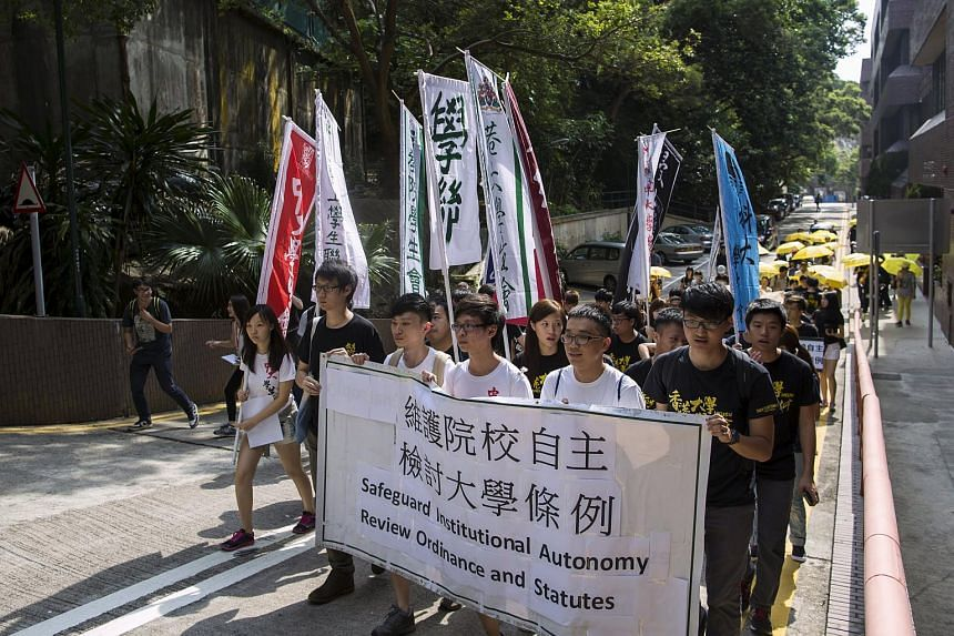 Members of University of Hong Kong (HKU) student union during a demonstration demanding the abolishment of a colonial rule that Hong Kong's leader is appointed as chancellor for all public universities.