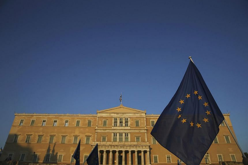 The European Union flag seen in front of the parliament building in Athens, Greece.
