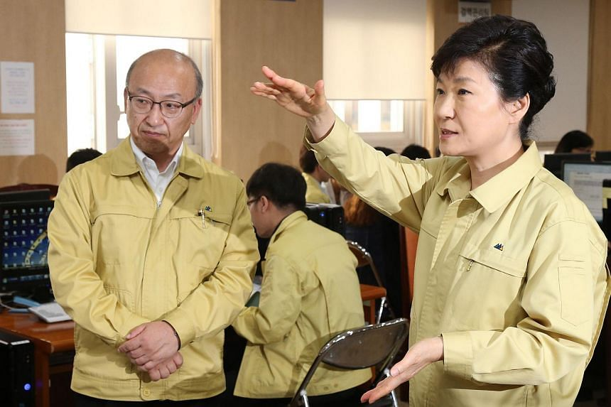 South Korean President Park Geun Hye (right) talking with Health Minister Moon Hyong Pyo (left) as she visits the Health and Welfare Ministry in Sejong, Seoul.