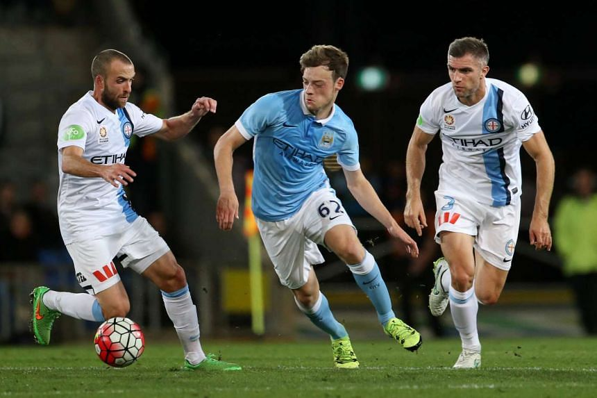 Manchester City's Brandon Barker (centre) in action.