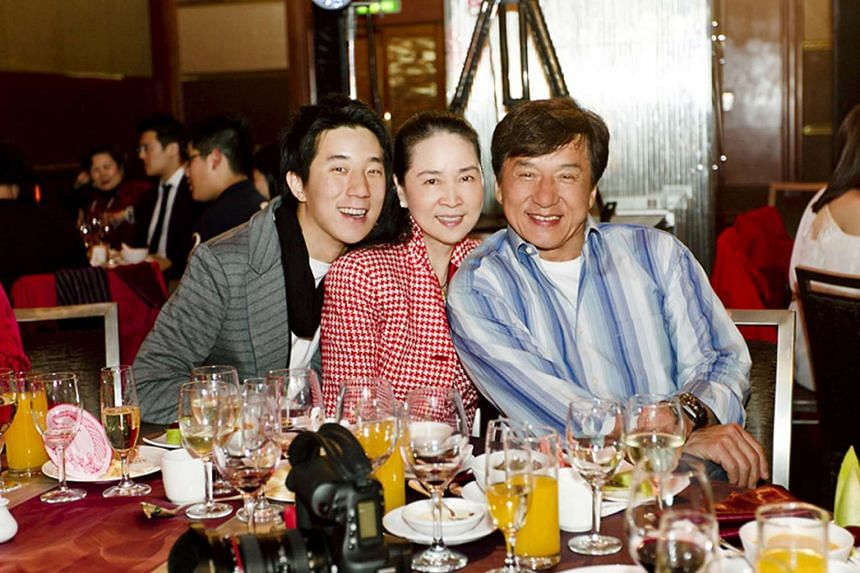 Jaycee Chan (left) with his parents, former actress Lin Feng-jiao and action superstar Jackie Chan at Lin's 60th birthday party in 2012.