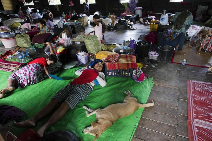 Flood-affected residents rest at an evacuation camp in Kalay, upper Myanmar's Sagaing region on Aug 3, 2015.