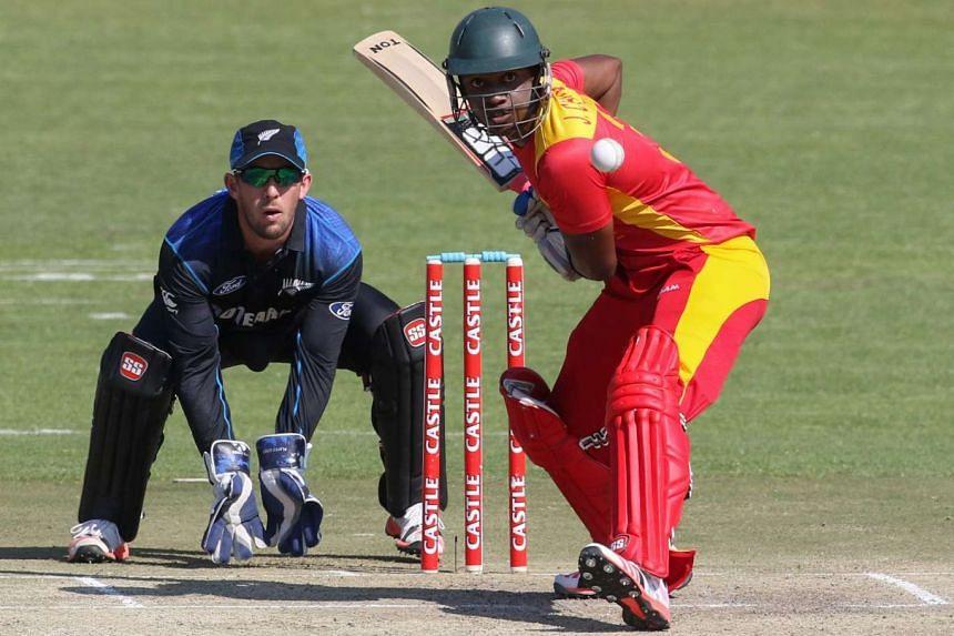 Zimbabwe batsman Chamunorwa Chibhabha bats as wicket keeper Luke Ronchi looks on during the first game in a series of three ODI cricket matches between Zimbabwe and New Zealand.