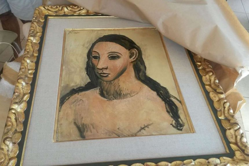 "A customs handout picture shows the seized painting ""Head of a young woman"" by famous Spanish painter Picasso."