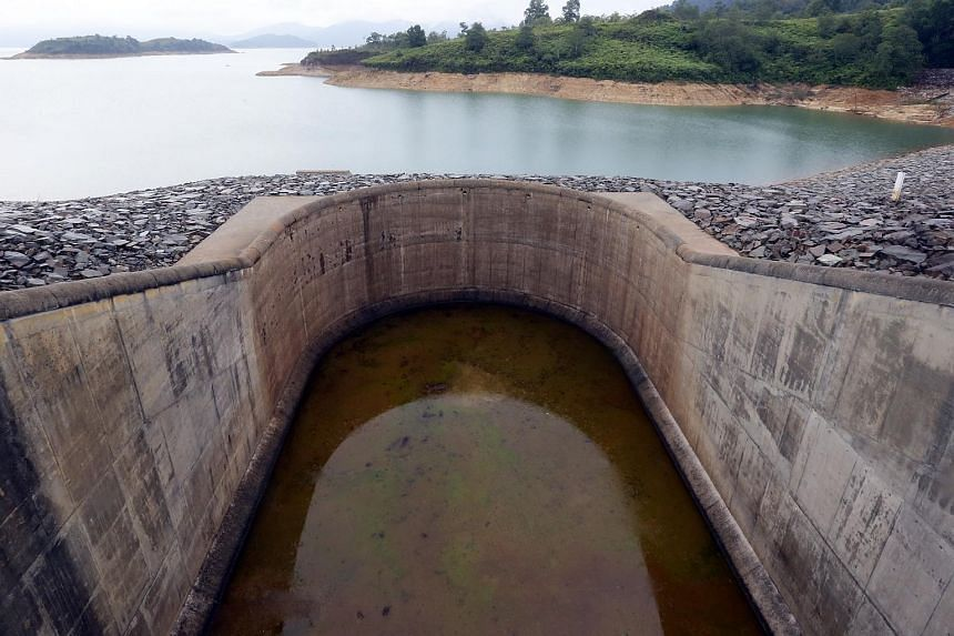 Linggiu Reservoir in Johor Bahru during Environment Minister Vivian Balakrishnan's visit. Water supplies at the reservoir have reached an alarming level of 55 per cent its maximum capacity.