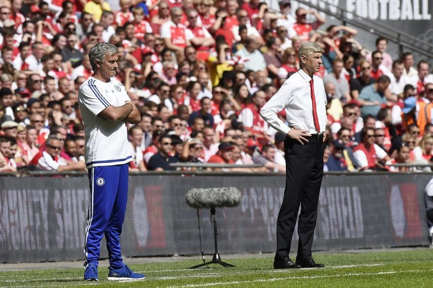 Chelsea manager Jose Mourinho (left) and his Arsenal counterpart Arsene Wenger standing close by as they watch their respective teams play in the Community Shield on Sunday. The two later continued their long-standing squabbles with Mourinho claiming that
