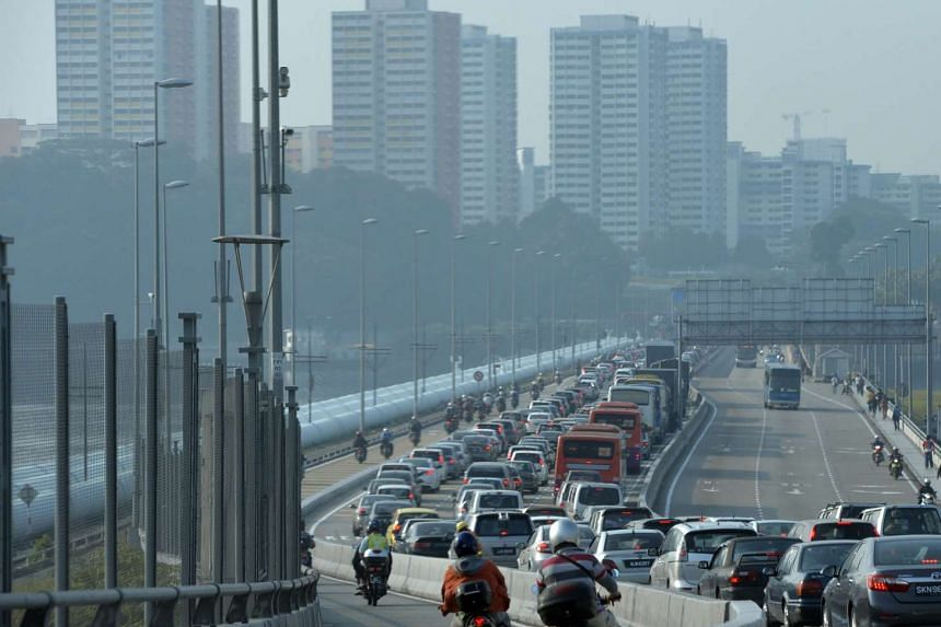 Cars caught in an early morning jam on the Singapore side of the Causeway.