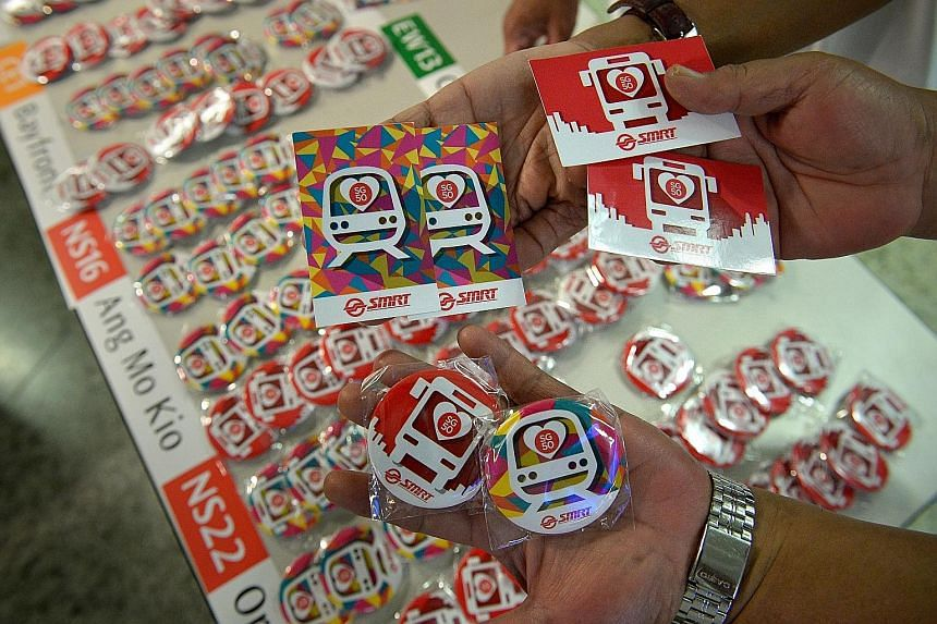 Some of the badges and EZ-link card stickers to be given away. On Sunday, commuters can board any public bus without having to tap in with their fare cards. Gantries at all MRT stations will also be kept open.