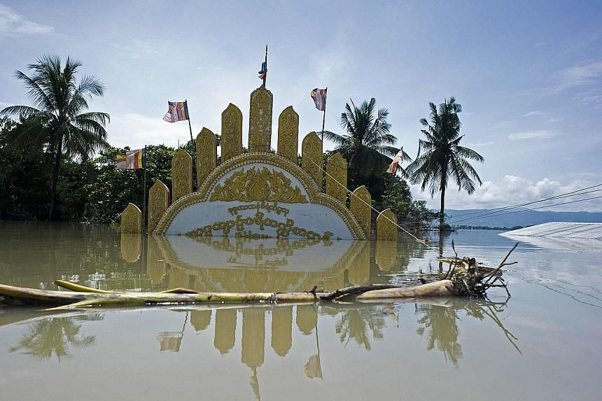 A monastery gate mostly submerged by floodwaters in Kalay in Myanmar's upper Sagaing region.
