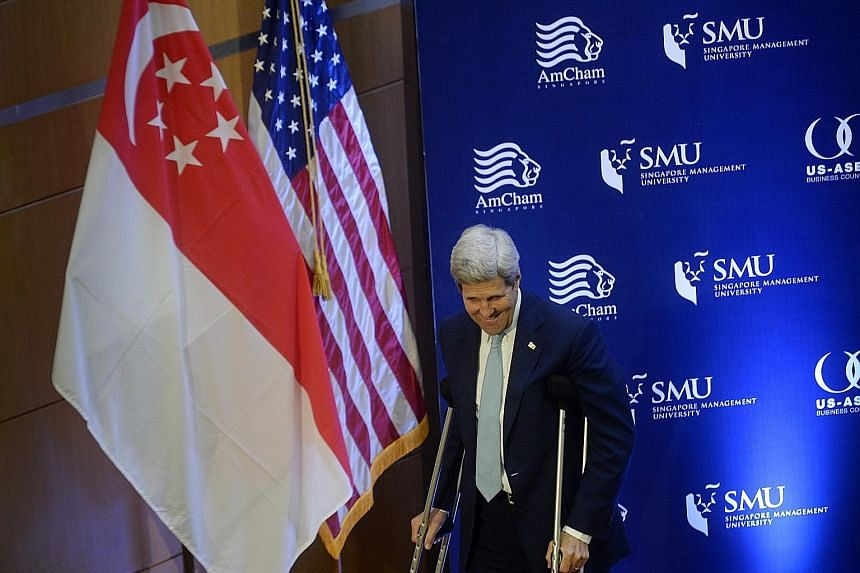 US Secretary of State John Kerry, on crutches after a cycling accident in Switzerland, at the Singapore Management University event yesterday. He said senior economic officials and chief innovation and technology officers from leading companies will