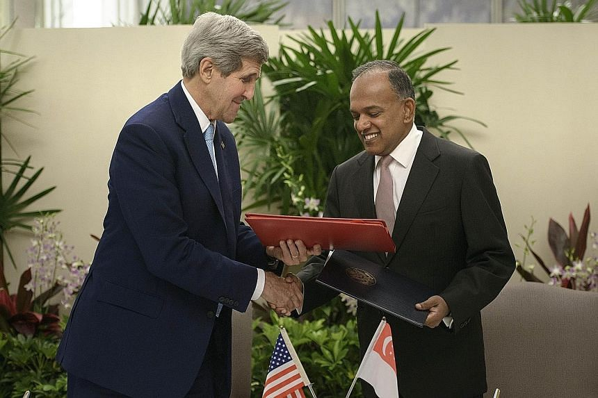US Secretary of State John Kerry and Foreign Minister K. Shanmugam at the signing of a memorandum of understanding yesterday.
