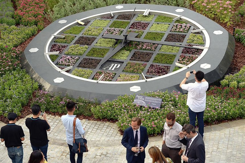 A giant floral clock made up of 5,000 plants was unveiled near the Supertree Grove at Gardens by the Bay yesterday by Minister for National Development Khaw Boon Wan. The 7m-wide timepiece will be refreshed regularly and showcases tropical plants not