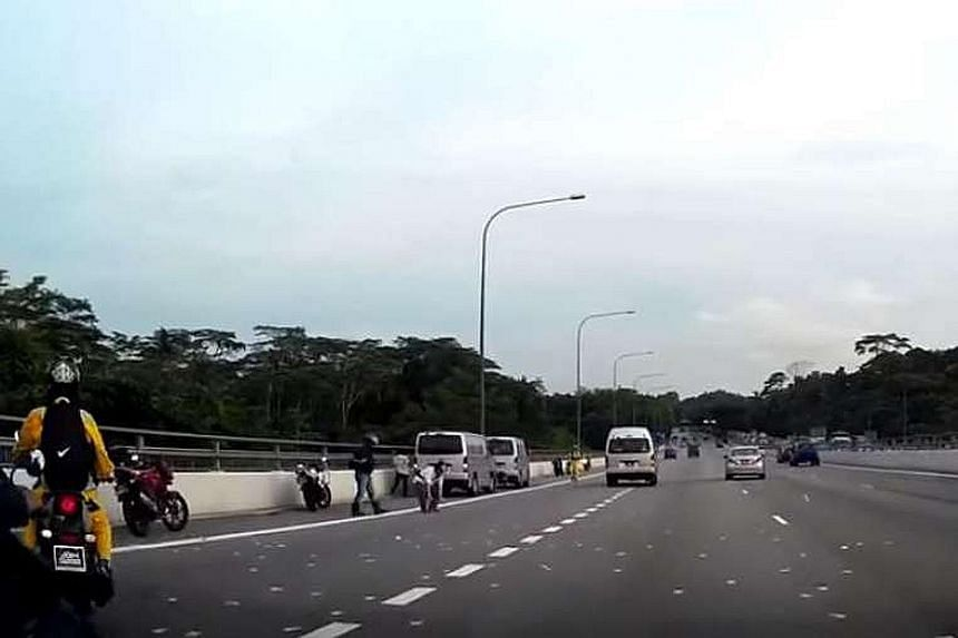 Screenshots from a video posted on YouTube showing motorists on the BKE stopping to pick up Malaysian ringgit notes on Monday evening.