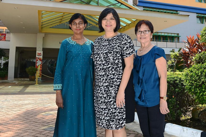 Yio Chu Kang Secondary's principal Janice Heng (centre) with maths teacher Annie Matthews (left), who joined the school in 1984, and contract teacher Mak Pak Lum, who joined in 1975.