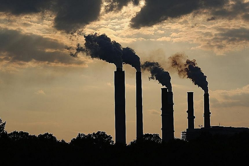 Emissions rising from stacks of a power plant in Indiana on July 23. Mr Obama's Plan is meant to put the US in a strong position at climate talks in Paris.