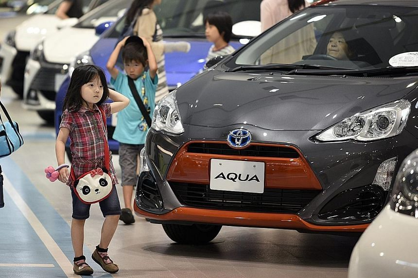 """Toyota sold 5.02 million vehicles in the six months to June 30, but the company has warned that it will be """"very difficult"""" to meet its annual sales target due to weak demand in emerging markets."""