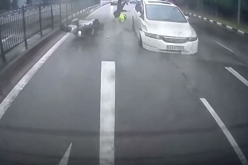 The motorcyclist sent flying after a white Honda MPV rammed his bike.