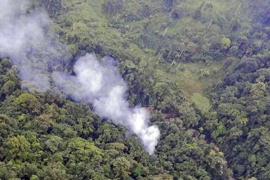 A handout picture released by the Colombian police shows smoke billowing from the site where a police Blackhawk helicopter went down killing 15 officers.