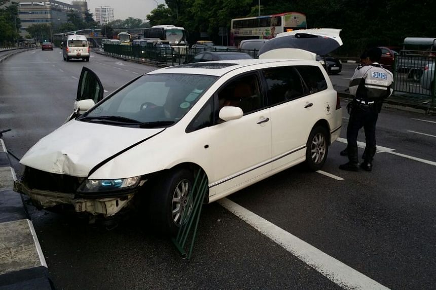 A Traffic Police officer searching the white Honda MPV.