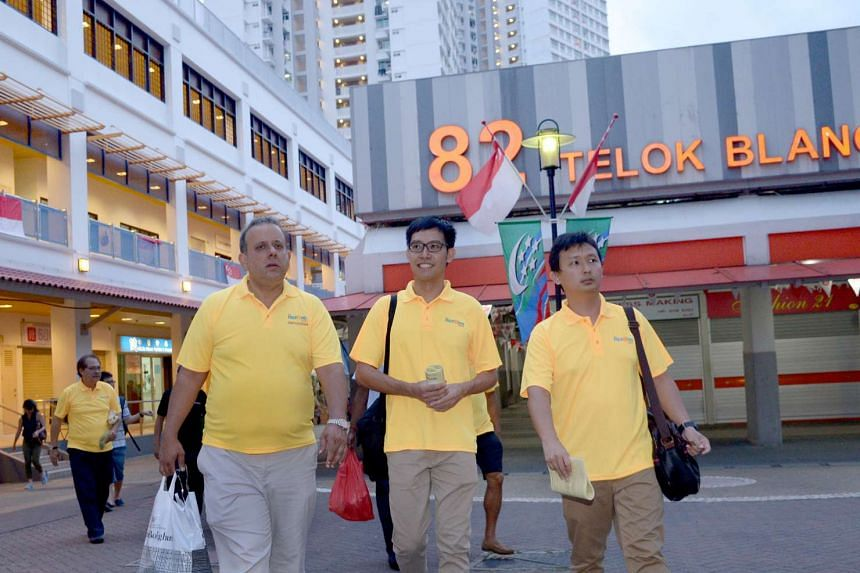 Roy Ngerng (centre) with Kenneth Jeyaretnam (left) and Desmond Teng at the Reform Party's walkabout in Telok Blangah on Aug 6, 2015.
