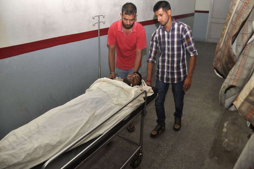The body of Indian villager Sanjay Kumar, 22, killed during cross-border firing on the India/Pakistan border, is shifted to the morgue.
