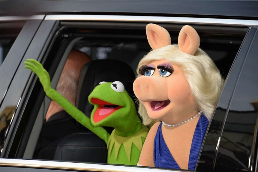 Kermit the Frog and Miss Piggy arrive for the world premiere of Disney's Muppets Most Wanted, at El Capitan Theatre in Hollywood, California, in 2014.