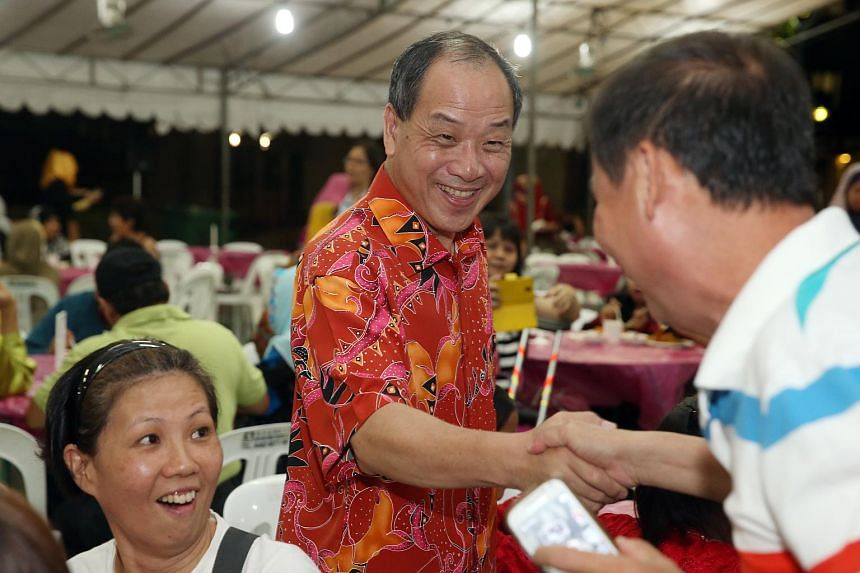 Workers' Party chief Low Thia Khiang greet residents at Hougang and Punggol East constituency Hari Raya celebration held at Blk 188A Rivervale Drive, on Aug 1, 2015.