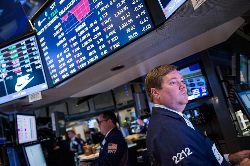 A trader working on the floor of the New York Stock Exchange.